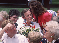 United States President George H.W. Bush listens to an unidentified woman during a Barbeque on the South Lawn of the White House in Washington, D.C. to commemorate the 20th anniversary of the Apollo 11 Moon landing on July 20, 1989. Visible in the foreground of the photo are U.S. Vice President Dan Quayle, left, and first lady Barbara Bush, right.<br /> Credit: Ron Sachs / CNP /ABACAPRESS.COM
