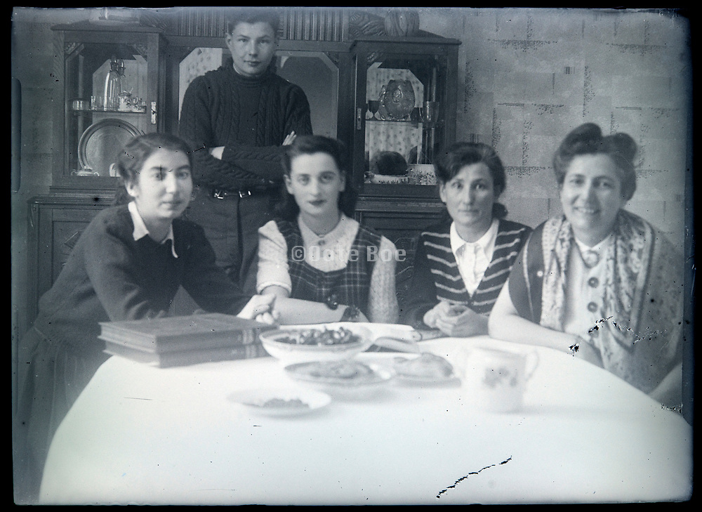 family sitting around the table France circa 1930s