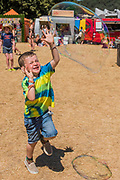 Children and adults are entertained by the giant bubbles from Bubble inc -The 2018 Latitude Festival, Henham Park. Suffolk 14 July 2018