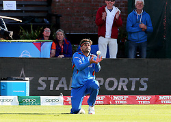Afghanistan's Hamid Hassan catches New Zealand's Colin Munro during the ICC Cricket World Cup group stage match at the County Ground Taunton.
