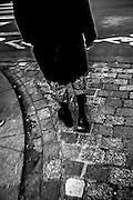 April 2015. Paris. A man walking on the streets.
