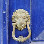 Old brass door knob with lion's head in Crete island, Greece