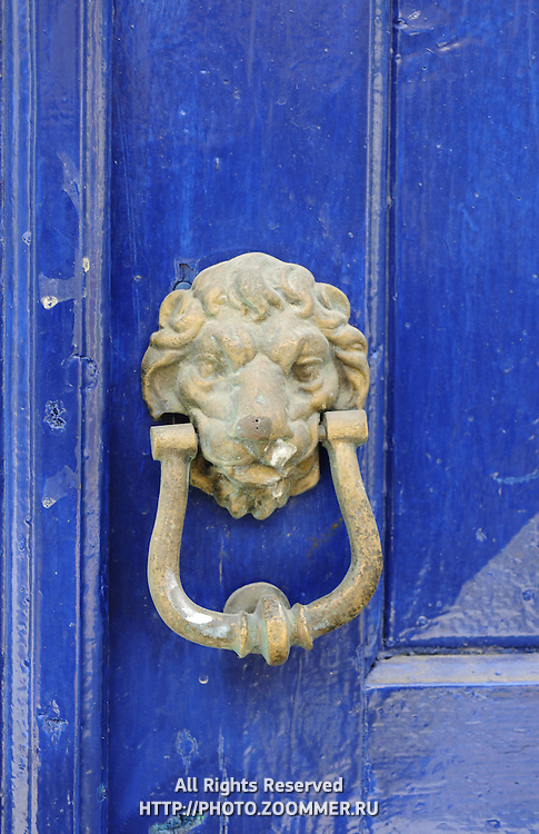 Old brass door knob with lion's head in Crete island, Greece