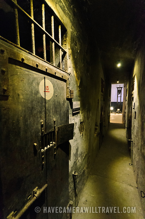 View of the corridor along death row, where prisoners destined for execution were kept in isolation. At left is one of the reinforced doors of the cells. In the distance, down the corridor, is one of the guillotines that the French colonial government used for executions. Hoa Lo Prison, also known sarcastically as the Hanoi Hilton during the Vietnam War, was originally a French colonial prison for political prisoners and then a North Vietnamese prison for prisoners of war. It is especially famous for being the jail used for American pilots shot down during the Vietnam War.