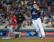 The Dodgers' Justin Turner throws out the Angels' Jefry Marte for the last out of the seventh inning during their Freeway Series game Friday night at Dodger Stadium.<br /> <br /> <br /> ///ADDITIONAL INFO:   <br /> <br /> freeway.0402.kjs  ---  Photo by KEVIN SULLIVAN / Orange County Register  --  4/1/16<br /> <br /> The Los Angeles Angels take on the Los Angeles Dodgers at Dodger Stadium during the Freeway Series Friday.<br /> <br /> <br />  4/1/16