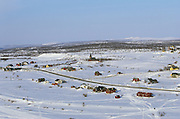 The town of Kautokeino, Finnmarksvidda, northern Norway, in wintertime. Its red, wooden church stands in the middle.  The town, which is mainly inhabited by ethnic Sami, is a Nordic centre of Sami culture. For the nomadic reindeer herders, Kautokeino is their winter home. In spring they move with their herds to summer pasture on the Atlantic coast, and in autumn they return to Kautokeino.