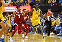 Feb 2, 2019; Morgantown, WV, USA; West Virginia Mountaineers forward Wesley Harris (21) passes the ball up the floor during the second half against the West Virginia Mountaineers at WVU Coliseum. Mandatory Credit: Ben Queen-USA TODAY Sports