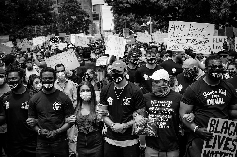 Protesters march for equality and Black Lives Matter.