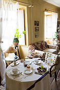 Table set for breakfast meal in stylish dining room Hotel Corps de Garde, at St Martin de Re, Ile de Re, France
