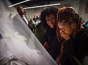 From right, Keyuna Grady and Encie Lee mourn while looking at the casket of their beloved father and husband at the funeral service at Calvary Christian Center in Elk Grove, Thursday, Sept. 12, 2019.