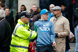 A Sunderland fan is ushered along by Police after taunting Newcastle United supporters - Photo mandatory by-line: Rogan Thomson/JMP - 07966 386802 - 21/12/2014 - SPORT - FOOTBALL - Newcastle upon Tyne, England - St James' Park - Newcastle United v Sunderland - Tyne-Wear derby - Barclays Premier League.