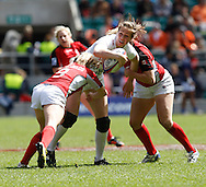 Photo by Andrew Tobin/Tobinators Ltd. Emily Scarratt of England in action from the IRB London Rugby 7s tournament held at Twickenham Stadium, London on 12th May 2013. New Zealand won the tournament beating Australia in the final, and also won the overall 2012/13 series.