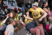 April, 18th, 2019 - London, Greater London, United Kingdom: Protesters locking on the boat to save it from removal. Demonstration against Climate Crisis. Extinction Rebellion is demanding the UK government takes urgent action on climate change and wildlife declines. Extinction Rebellion activists disrupt traffic around famous London Landmarks. Thousands of protesters  converging on central hubs including Oxford Circus and Parliament Square. Nigel Dickinson/Polaris