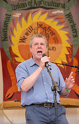 © Licensed to London News Pictures. 21/07/2019; Tolpuddle, Dorset, UK. MARK SERWOTKA, General Secretary of the Public and Commercial Services Union (PCS), the largest trade union representing British civil servants and also President of the Trades Union Congress, speaks on the main stage at the Tolpuddle Martyrs Festival. The Tolpuddle Martyrs Festival for trade unionism, held every year, commemorates the birth of the trade union movement in the 19th century when the Tolpuddle Martyrs were transported to Australia for forming a trade union of agricultural labourers in Dorset. Photo credit: Simon Chapman/LNP.