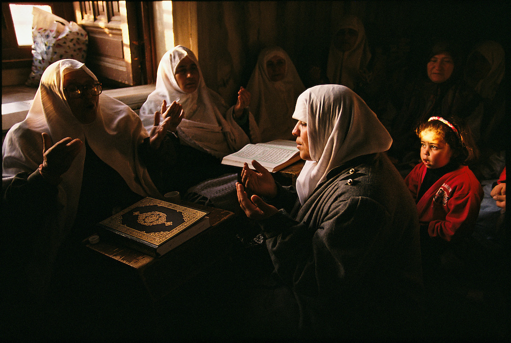 Muslim women at prayer.