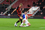 Martin Kelly (34) of Crystal Palace makes a crucial tackle on Sam Surridge (14) of AFC Bournemouth during the EFL Cup match between Bournemouth and Crystal Palace at the Vitality Stadium, Bournemouth, England on 15 September 2020.