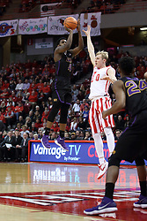 17 February 2018:  Isaac Gassman can't stop the shot by Tywhon Pickford during a College mens basketball game between the University of Northern Iowa Panthers and Illinois State Redbirds in Redbird Arena, Normal IL