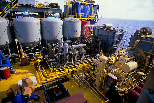 Stock photo of a view of piping and storage tanks on an oil tanker