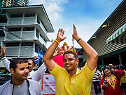 "23 SEPTEMBER 2018 - BANGKOK, THAILAND: Men dance during the Ganesha procession in Bangkok. Ganesha Chaturthi also known as Vinayaka Chaturthi, is the Hindu festival celebrated on the day of the re-birth of Lord Ganesha, the son of Shiva and Parvati. The festival, also known as Ganeshotsav (""festival of Ganesha"") is observed in the Hindu calendar month of Bhaadrapada, starting on the the fourth day of the waxing moon. The festival lasts for 10 days, ending on the fourteenth day of the waxing moon. Outside India, it is celebrated widely in Nepal and by Hindus in the United States, Canada, Mauritius, Singapore, Thailand, Cambodia, and Burma.  PHOTO BY JACK KURTZ"