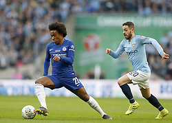 BRITAIN-LONDON-FOOTBALL-CARABAO CUP FINAL-CHELSEA VS MAN London.(190224) -- LONDON, Feb. 24, 2019  Cheslea's Willian gets away from Manchester CIty's Bernardo Silva during the Carabao Cup Final match between Chelsea and Manchester City at Wembley Stadium in London, Britain on Feb. 24, 2019. Manchester City won 4-3 on penalties after a 0-0 draw.  FOR EDITORIAL USE ONLY. NOT FOR SALE FOR MARKETING OR ADVERTISING CAMPAIGNS. NO USE WITH UNAUTHORIZED AUDIO, VIDEO, DATA, FIXTURE LISTS, CLUB/LEAGUE LOGOS OR ''LIVE'' SERVICES. ONLINE IN-MATCH USE LIMITED TO 45 IMAGES, NO VIDEO EMULATION. NO USE IN BETTING, GAMES OR SINGLE CLUB/LEAGUE/PLAYER PUBLICATIONS. (Credit Image: © Matthew Impey/Xinhua via ZUMA Wire)