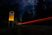 Authorities have installed signs on dark country roads with high roadkill numbers as a reminder to motorists that Tasmanian devils are likely to be on the roads during the night, being so dark in colour they are very hard to see let alone avoid.