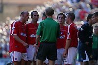 Photo: Jo Caird<br />Charlton v Manchester United at The Valley.<br />13/09/2003.<br />Ref  Mike Riley is surrounded by Charlton players as Jason Euell is sent off