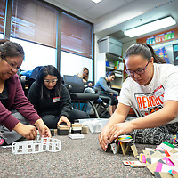 Lisa Lee, 30, left, April Delacruz, 30, center, and Crystal Morris, 30, right, use the different materials to create playtime ideas for kids, during the Weimagination class at the UNM-Gallup campus on Nov. 30th.