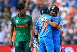 India's Rohit Sharma is congratulated on reaching his century by team-mate Virat Kohli during the ICC Champions Trophy, semi-final match at Edgbaston, Birmingham.