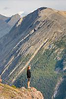 Hiker gazing at views from Parker Ridge, Banff National Park Alberta Canada