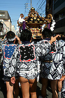 Fundoshi at Sanja Matsuri - the biggest of Tokyo's three Grand Festivals and a splurge of boisterous mikoshi processions through the streets of Asakusa.  There's plenty of drinking, dancing, music and other kinds of fun. Held near Sensoji Temple and Asakusa Shrine in Tokyo the parade draws over two million people into the streets.  The gold and black lacquer mikoshi are the vehicles of the shrine's deities - the purpose of the procession is to bring luck and prosperity to the area and its inhabitants and show off ones' buns.