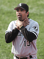Chicago White Sox manager Ozzie Guillen gestures to Cleveland Indians fans and Tribe mascot Slider during a pitching change yesterday at Jacobs Field. The White Sox swept the Indians to keep Cleveland from earning a playoff spot despite a torrid second half.
