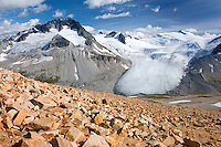 Tongue-like glacier flowing down between Mount Ethelweard (left) 2819 m (9249 ft) and Icemaker Mountain 2745 m (9006 ft), Coast Mountains British Columbia Canada