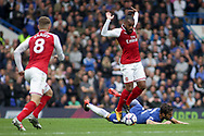 Alexandre Lacazette of Arsenal battles for the ball with Cesc Fabregas of Chelsea . Premier league match, Chelsea v Arsenal at Stamford Bridge in London on Sunday 17th September 2017.<br /> pic by Kieran Clarke, Andrew Orchard sports photography.