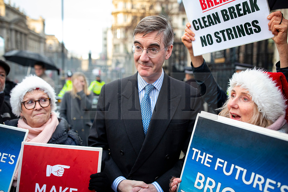 © Licensed to London News Pictures. 20/12/2019. London, UK. Leader of the Commons Jacob Rees-Mogg joins Brexit supporters as they celebrate outside parliament after MPs voted to pass Boris Johnson's Withdrawal Agreement Bill. Photo credit: Rob Pinney/LNP