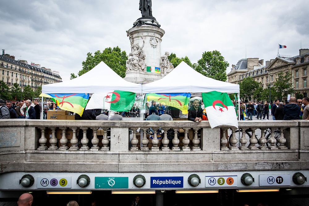 May 26, 2019 - Paris, Ile-de-France (region, France - Hundreds of people, Algerians and Franco-Algerians, gather at the Place de la Republique, in Paris, in support of protests in Algeria, with slogans such as - that they all leave - or - The united people will never be defeated - and brandishing Algerian flags. (Credit Image: © Sadak Souici/Le Pictorium Agency via ZUMA Press)