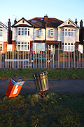 Bent rubbish bins in front of Edwardian era semi-detached houses on Ruskin Park, Denmark Hill, SE24 London