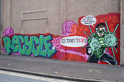 Graffiti style text of the word recycle on a wall for a recycling company on 3rd August 2021 in Birmingham, United Kingdom. Recycling is the process of converting waste materials into new materials and objects. The recovery of energy from waste materials is often included in this concept.