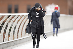 © Licensed to London News Pictures. 04/05/2021. London, UK. Windy conditions for pedestrians crossing the Millennium footbridge over the River Thames in the City of London. High winds and heavy rain are affecting parts of the UK today. Photo credit: Peter Macdiarmid/LNP