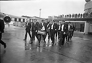 The Irish Rugby touring team left Dublin Airport on Saturday 22nd April, 1967 on an Aerlingus flight to New York, en route to Australia for a 4 week tour,..Irish Rugby Football Union, Irish team departs for Australian tour, 22nd April 1967, 22.4.67, 4.22.67,.