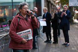London, UK. 8 October, 2019. Hannah Caller of the Focus E15 campaign addresses campaigners from Architects for Social Housing (ASH) protesting outside the award ceremony for the Riba Stirling Prize at the Roundhouse. ASH were protesting against the Royal Institute of British Architects' (RIBA) nomination of the architecture of social cleansing, estate demolition and housing privatisation for the Stirling Prize, against the false promotion of council-owned commercial housing development and management companies as a so-called 'renaissance in social housing' and against the association of the name of socially committed architect, the late Neave Brown, with the architecture of Neo-liberalism. Credit: Mark Kerrison/Alamy Live News