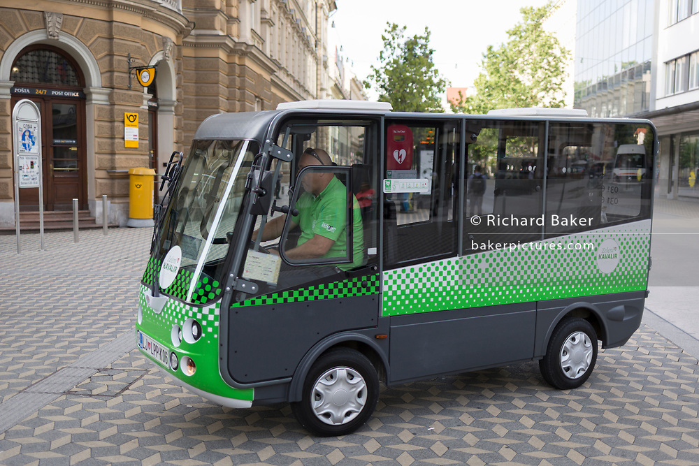 """A zero emission electric Kavalier vehicle on Slovenska Cesta (street) in the Slovenian capital, Ljubljana, on 25th June 2018, in Ljubljana, Slovenia. The """"Kavalier"""", is an environmentally friendly concept of free city transport in Ljubljana which drive in the pedestrian zone of the old town center are mainly intended for older citizens, people with reduced mobility and tourists. Because of the low speed you can stop and board a """"cavalier"""" while driving, but you can also order it by phone."""
