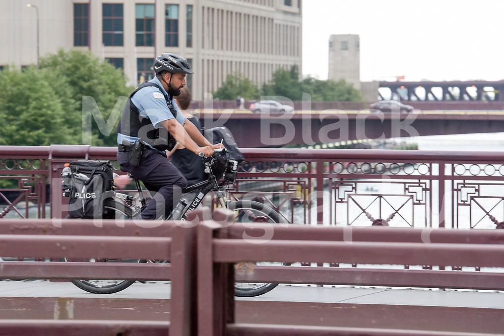 Chicago Police bike unit cross the Michigan Avenue bridge over the Chicago River in Chicago, Illinois. Photo by Mark Black
