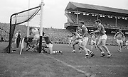 GAA All Ireland Minor Football final Cork V. Offaly 27th September 1964 at Croke Park...Offaly goalie M. Furlong is bowelled over by the line by, Cork forwards but goal disallowed..27.9.1964  27th September 1964