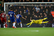 Chelsea Goalkeeper Thibaut Courtois is at full stretch as a shot from Mohamed Salah of Liverpool (not in picture)  goes past his post. Premier League match, Liverpool v Chelsea at the Anfield stadium in Liverpool, Merseyside on Saturday 25th November 2017.<br /> pic by Chris Stading, Andrew Orchard sports photography.