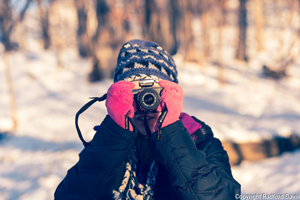 Snow girl with camera