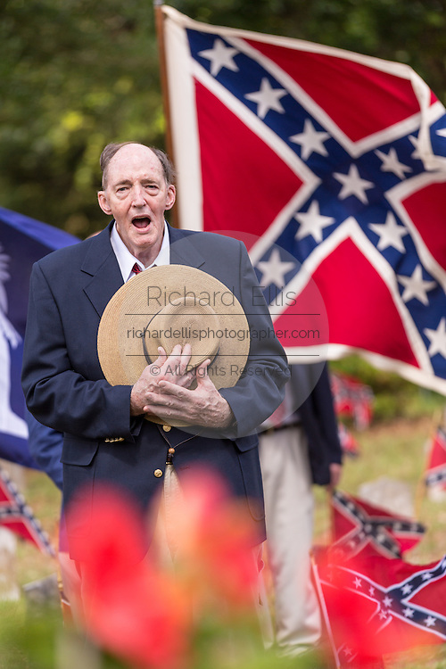 """A descendant of Civil War soldiers sings """"Dixie"""" during a ceremony marking Confederate Memorial Day at Magnolia Cemetery April 10, 2014 in Charleston, SC. Confederate Memorial Day honors the approximately 258,000 Confederate soldiers that died in the American Civil War."""