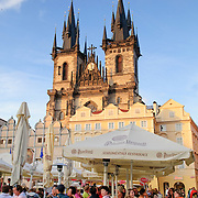 Tourists dining at a cafe in Prague's Old Town Square
