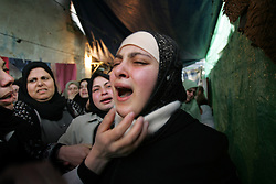 Relatives mourn after seeing the body of Yasser Dahlan, one of 15 dead militants returned to Gaza residents after being held by Israel, Gaza, Palestinian Territories, Feb. 7, 2005. The Israeli military delivered the bodies to the Palestinians for burial, a handover celebrated in Gaza as the first real achievement of Palestinian leader Mahmoud Abbas, also known as Abu Mazen, who is trying to prevent militants from straying from a fragile truce.