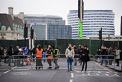 © Licensed to London News Pictures. 31/12/2016. London, UK. Steel barriers put in place to close off Westminster Bridge in  London ahead of tonight's New Year celebrations. Security surrounding this year's event has been heightened following a terrorist attack at a Christmas market in Berlin earlier this month. Photo credit: Ben Cawthra/LNP