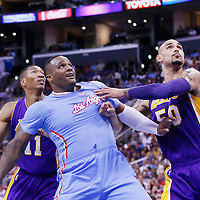 06 April 2014: Los Angeles Clippers forward Glen Davis (0) vies for the rebound with Los Angeles Lakers center Robert Sacre (50) and Los Angeles Lakers forward Wesley Johnson (11) during the Los Angeles Clippers 120-97 victory over the Los Angeles Lakers at the Staples Center, Los Angeles, California, USA.